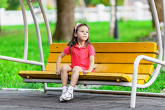 Pretty little girl on swing bench Royalty Free Stock Images