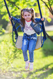 Pretty little girl swinging on seesaw Stock Images