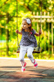 Pretty little girl swinging on seesaw Royalty Free Stock Images