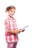 Pretty little girl with a Tablet PC Stock Photos