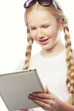 Pretty little girl with a Tablet PC Stock Photo