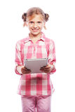 Pretty little girl with a Tablet PC Royalty Free Stock Photography