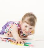 Pretty little girl taking many felt-tip pens Stock Photo