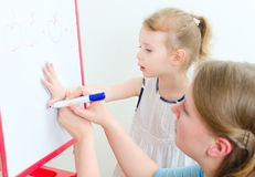 Pretty little girl with teacher Stock Image