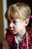 Pretty little girl with a tear on her cheek. Upset little girl in a red jacket crying and tears running down her cheeks Royalty Free Stock Photography