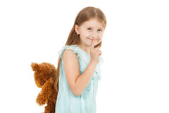Pretty little girl with teddy bear isolated Stock Images