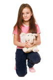 Pretty little girl with a teddy elephant Stock Photography