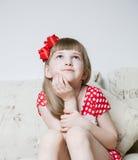 Pretty little girl thinking Stock Photo