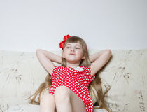 Pretty little girl thinking Royalty Free Stock Photos