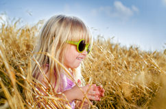 Pretty little girl in trendy yellow sunglasses Stock Images