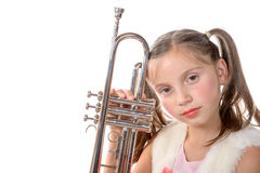 A pretty little girl with a trumpet look at the camera Royalty Free Stock Image