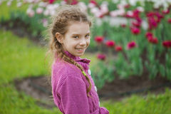 Pretty little girl in tulip park Royalty Free Stock Photos