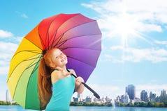 Pretty little girl with an umbrella. Pretty little girl with a colorful umbrella Royalty Free Stock Image
