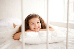 Pretty little girl waking up in the morning. Royalty Free Stock Photos