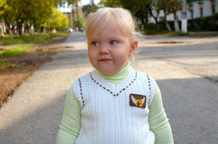 Pretty little girl walk in the park. Stock Photography
