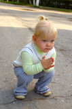 Pretty little girl walk in the park. Royalty Free Stock Images