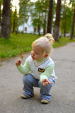 Pretty little girl walk in the park. Stock Photos