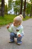 Pretty little girl walk in the park. Stock Photos