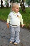 Pretty little girl walk in the park. Stock Photo