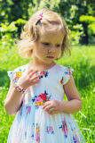 Pretty little girl walking in the Park. Stock Images