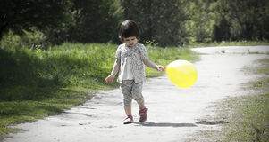Pretty little girl walks in the park Royalty Free Stock Images
