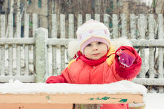 Pretty little girl in winter outerwear Royalty Free Stock Image