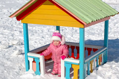 Pretty little girl and winter playground. Stock Photography