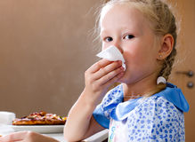 Pretty little girl wiping her mouth with a napkin Royalty Free Stock Photography
