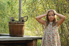 Pretty little girl with wooden bucket royalty free stock images