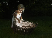Pretty little girl in the woods with a basket Royalty Free Stock Photo