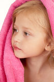 Pretty little girl wrapped in a pink towel. Close-up Stock Photos