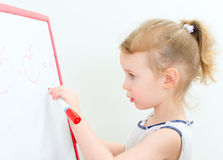 Pretty little girl writing Royalty Free Stock Images