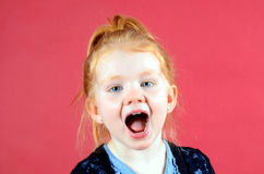 Pretty little girl yelling. Little redhead girl with blue eyes yelling Royalty Free Stock Images