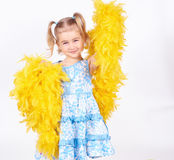 Pretty little girl with the yellow boa Royalty Free Stock Photography