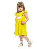 A pretty little girl in a yellow dress Stock Photo