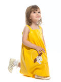 A pretty little girl in a yellow dress Stock Photography