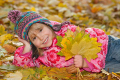 Pretty little girl with yellow leaves Stock Photo