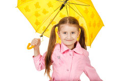 Pretty little girl with yellow umbrella isolated on white backgr Royalty Free Stock Photography