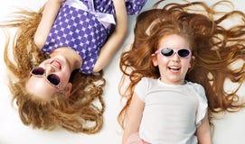 Pretty little girls having a great fun Stock Image