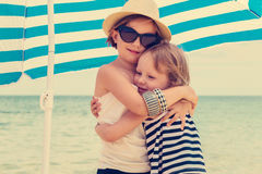 Pretty little girls (sisters) on the beach. Selective focus Royalty Free Stock Photo