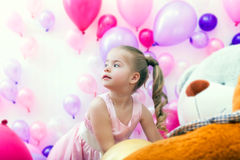 Pretty little lady posing on balloons backdrop Royalty Free Stock Images