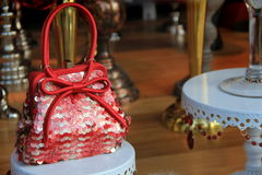 Pretty little red purse in shop window Royalty Free Stock Photo