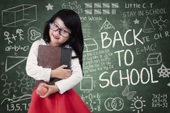 Pretty little schoolgirl back to school Royalty Free Stock Photography