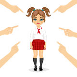 Pretty little schoolgirl being accused with fingers pointing at her Stock Photo
