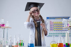 Pretty little scientist posing with glasses in lab Royalty Free Stock Photos