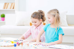 Pretty little sisters painting Royalty Free Stock Images