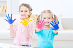 Pretty little sisters painting stock images
