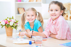 Pretty little sisters painting royalty free stock photos