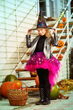 Pretty little wizard. Beautiful little girl in a costume of witch celebrating halloween. Trick or treat. Halloween party Stock Photo