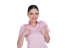 Pretty lively brunette giving a thumbs up gesture Royalty Free Stock Images